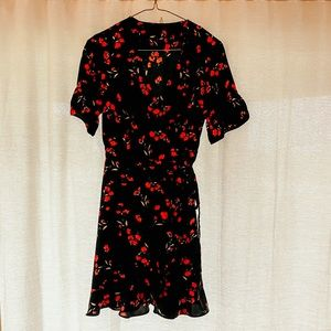 Black wrap dress with red flowers by The Standard
